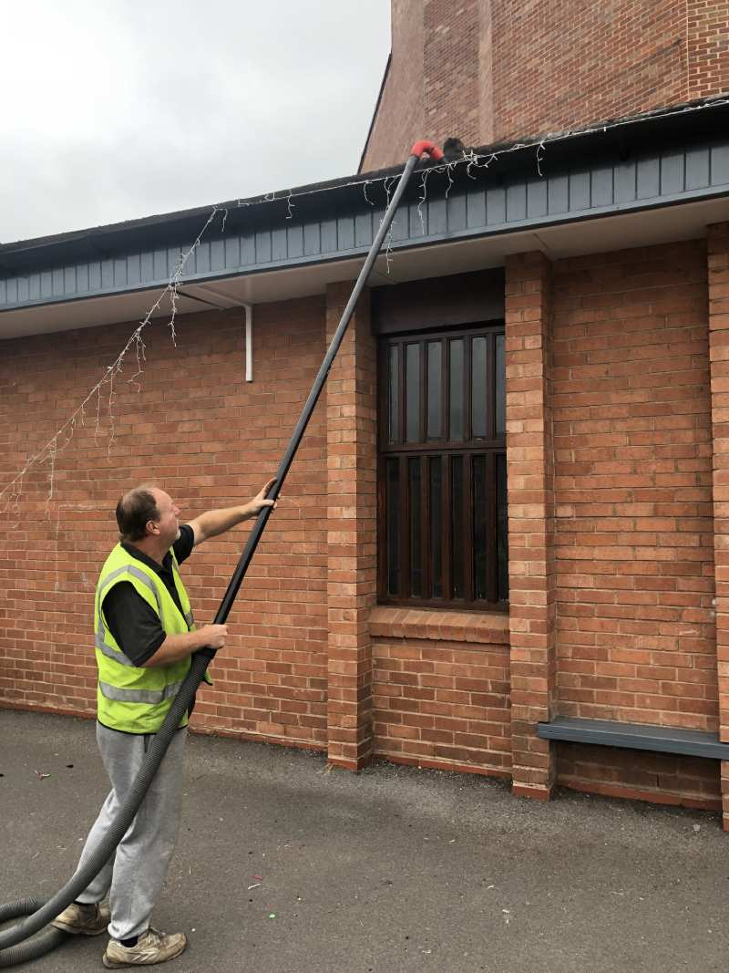 good business man cleaning gutters